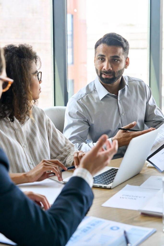 Diverse Executive Business Team Group Discuss DemandLab's marketing pillars